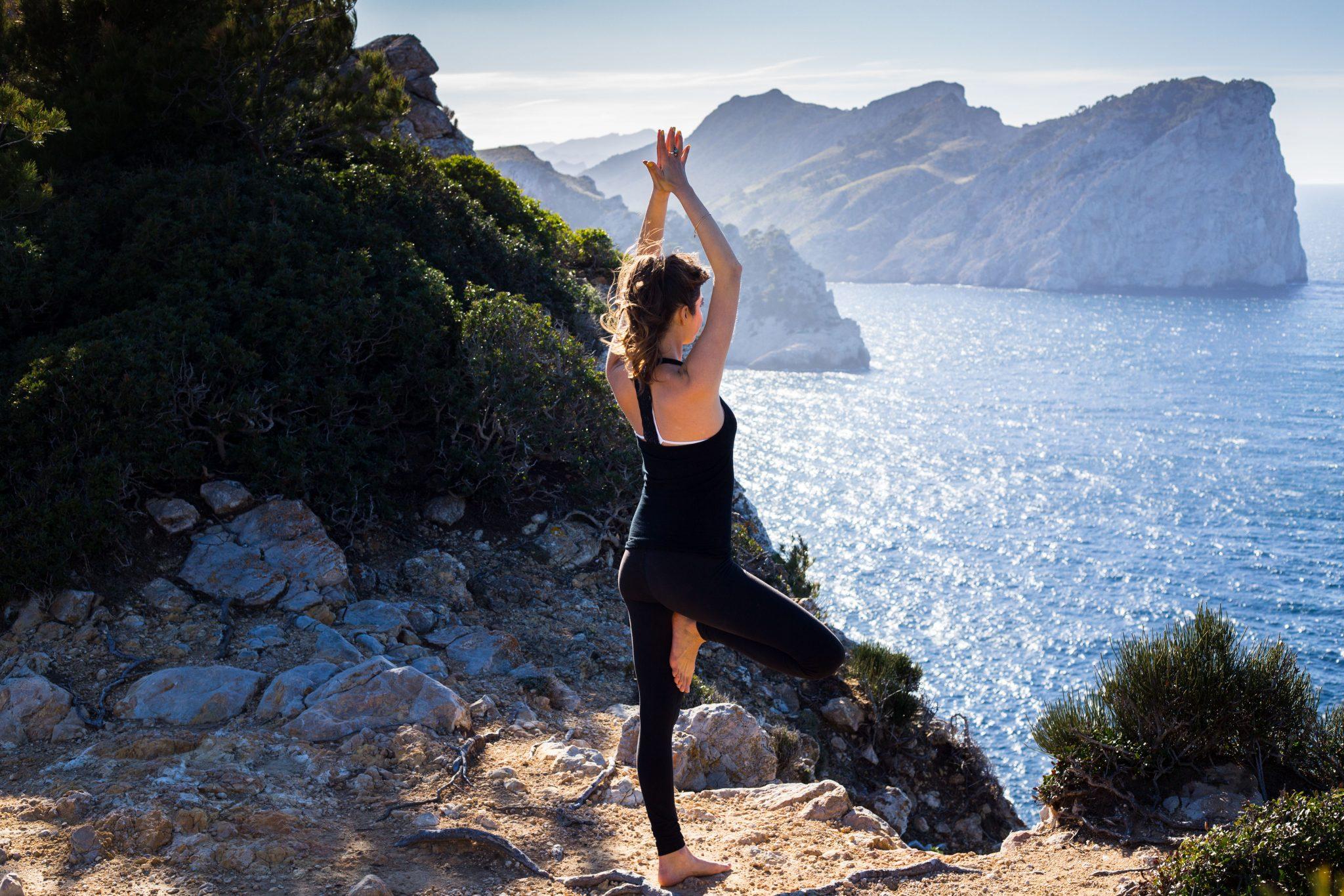 Kaeli Renae doing Yoga